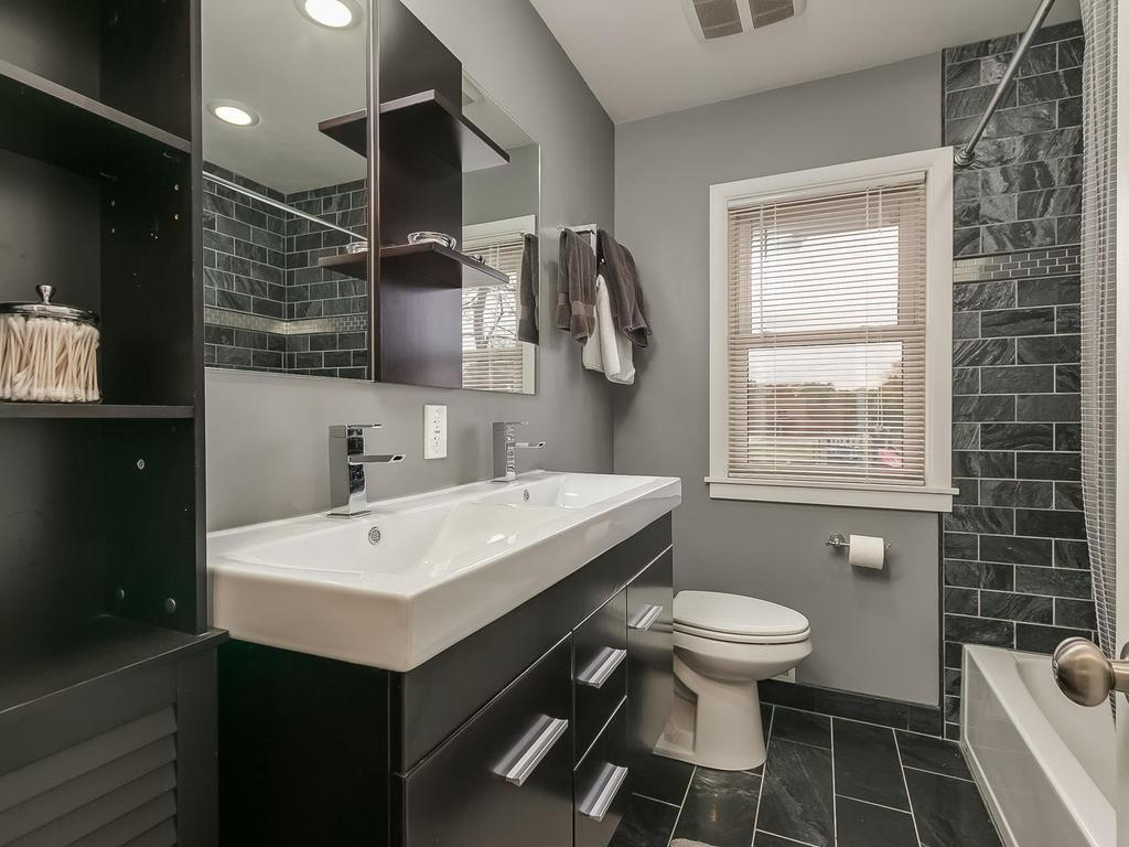 Stunning bathroom with double vanity, heated floors, modern finishes and tile surround full bath.