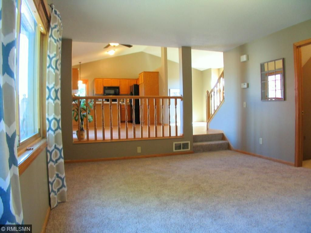 View from the family room into the kitchen/dining area is open and spacious.
