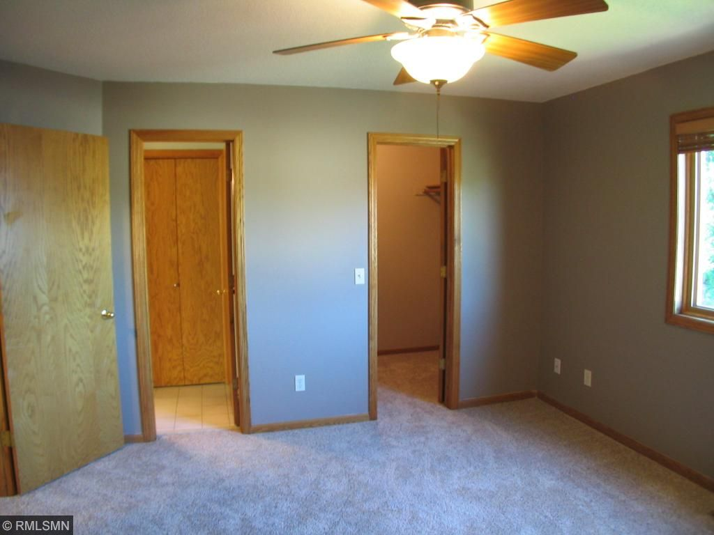 Walk in closet for owners bedroom and private entrance to the large bath.