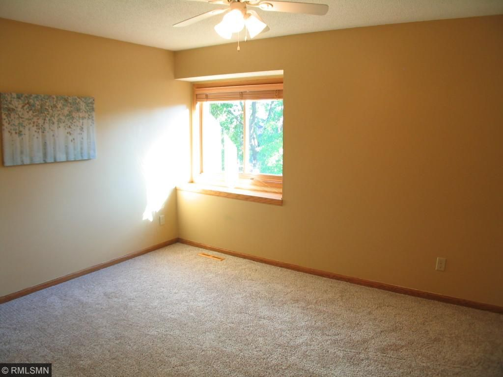 Second bedroom on upper level with boxed bay window and walk in closet.