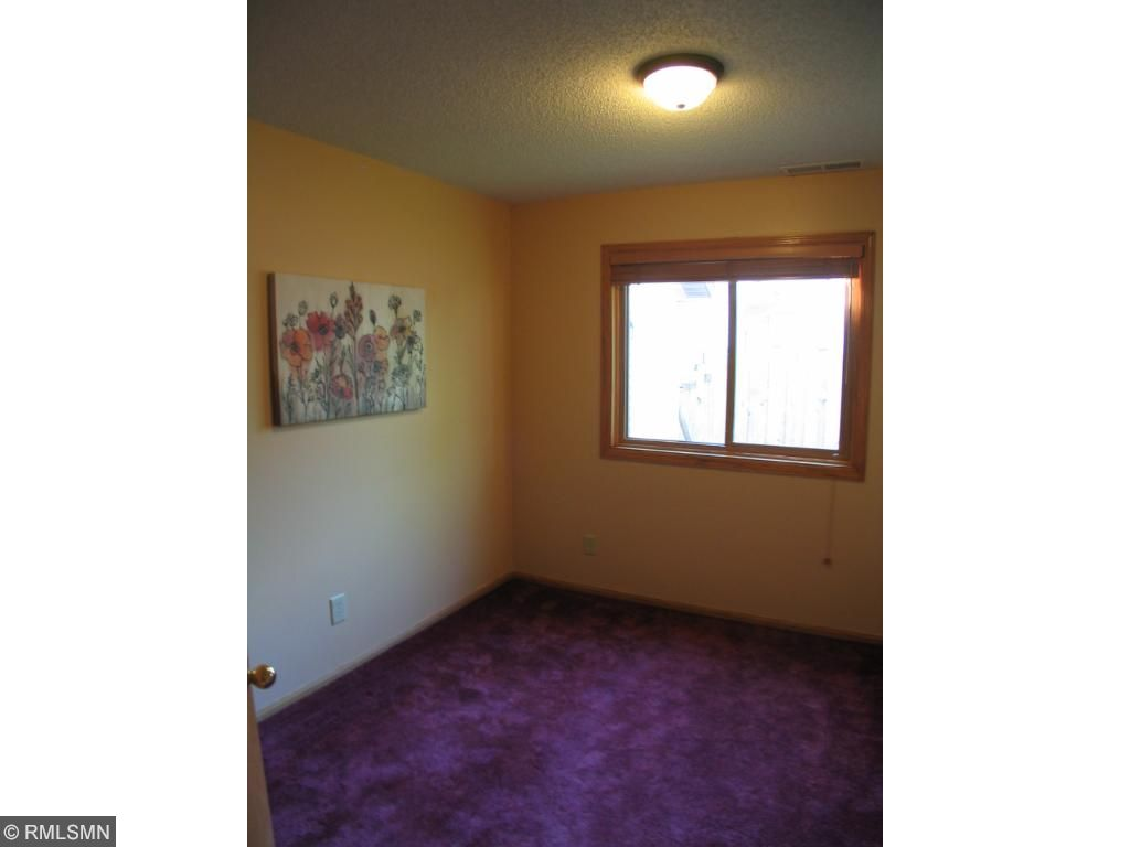 Third bedroom on main level is private and would make a wonderful home office.