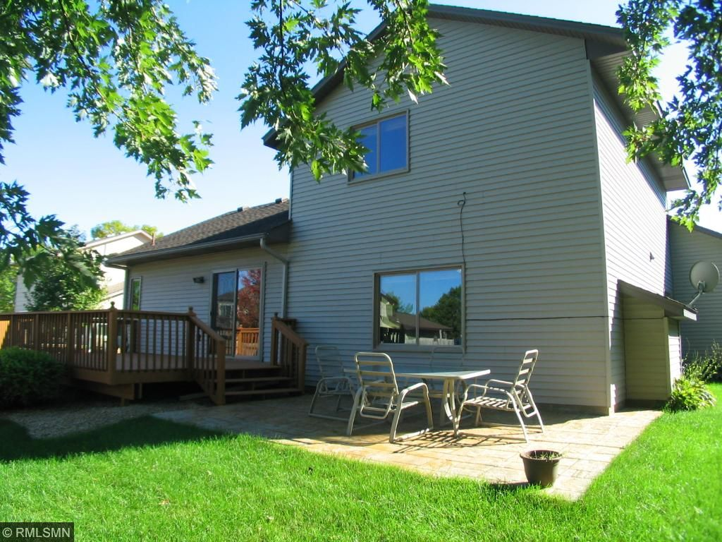 Rear yard includes a freshly stained deck and stamped concrete patio area.  Totally fenced in.
