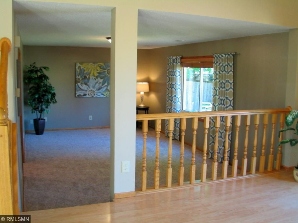 First floor family room is open to the kitchen and dining areas.  All structure for a fireplace is already there in the far wall.  Easy to install.