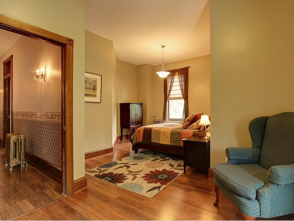 One of the five bedrooms on the second floor.
