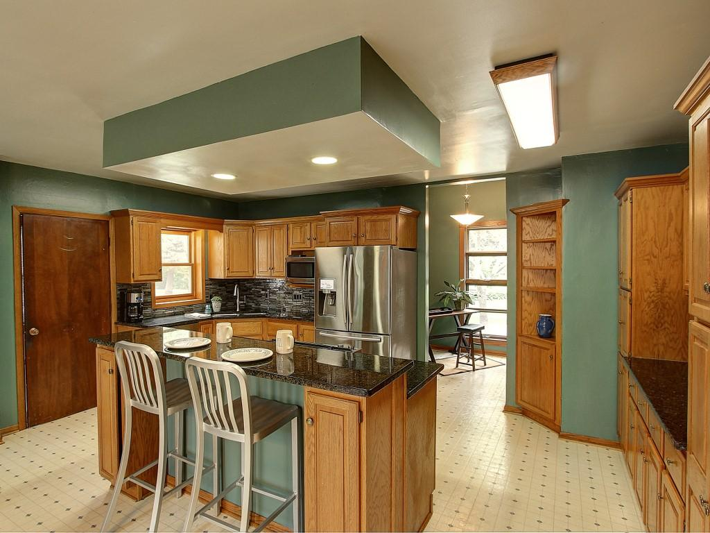 All the kitchen appliances are stainless steel and the Jenn-Air oven in the island has a down draft exhaust.