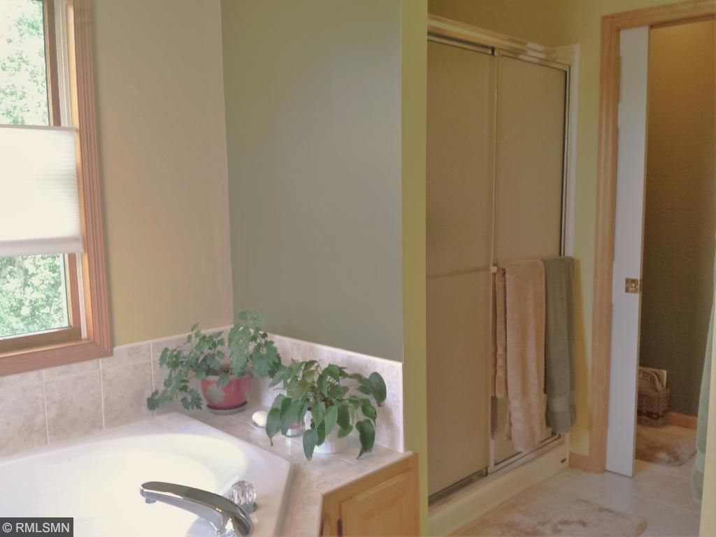 master bath stand up shower and pocket door for privacy