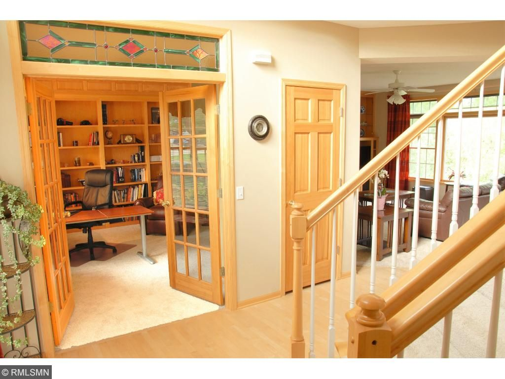 Stain glass transom entering den w/fir french doors and built in shelving