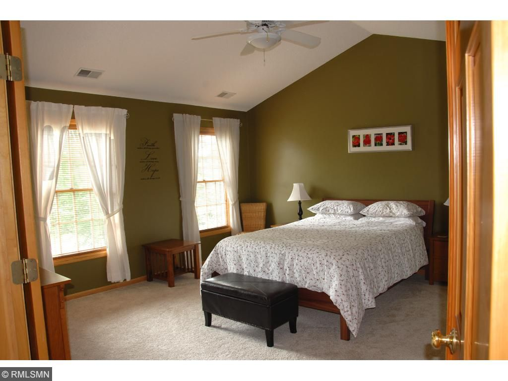 Master bedroom with vaulted ceilings.
