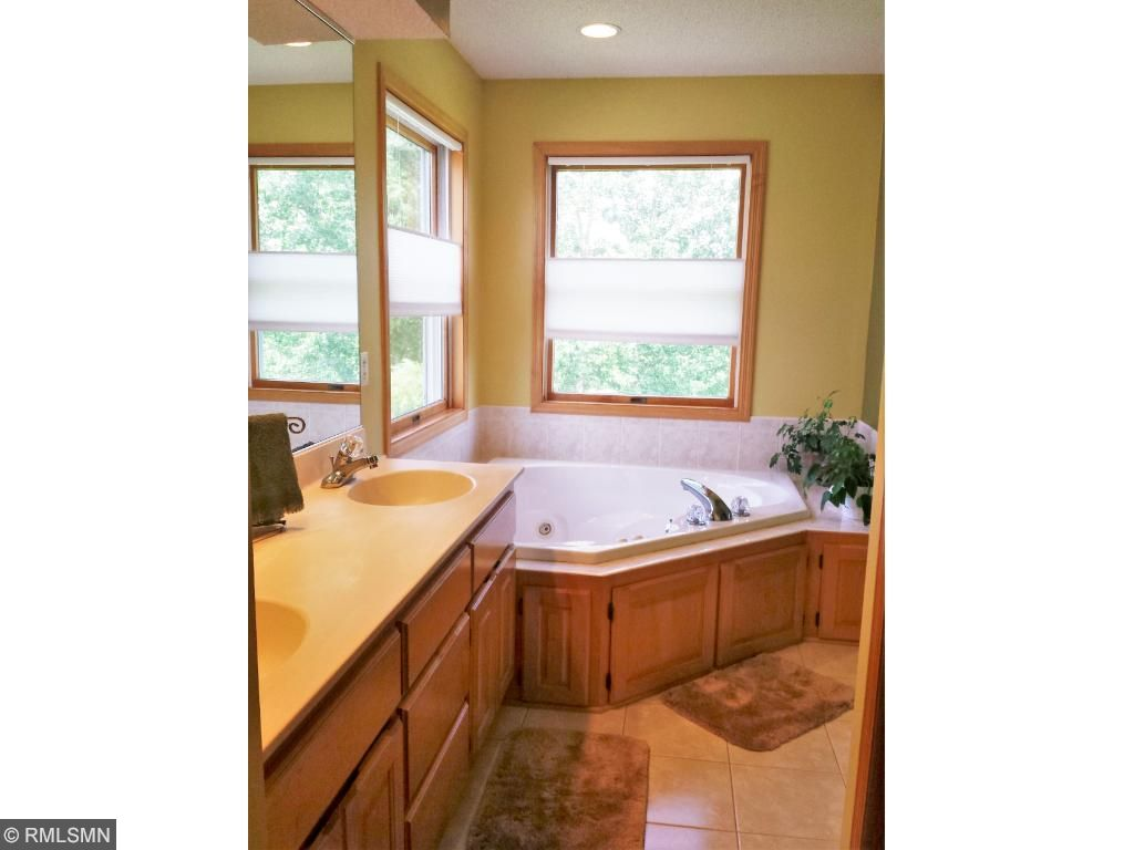 Master bath with double sinks, jacuzzi, stand up shower and walk in closet.
