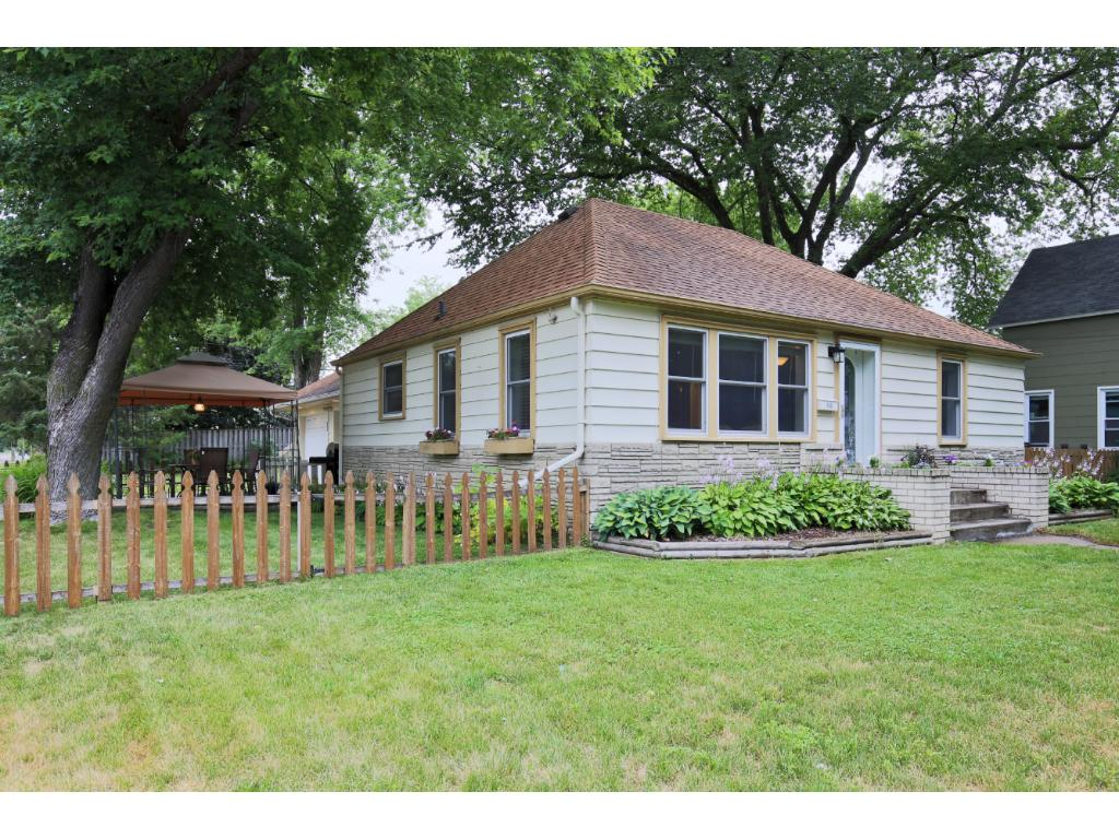 This fantastic Hopkins home sits on a great lot and the lower level is set up to rent out as it has its own entrance and has a living room, full kitchen, 2 bedrooms with egress windows and a full bath.