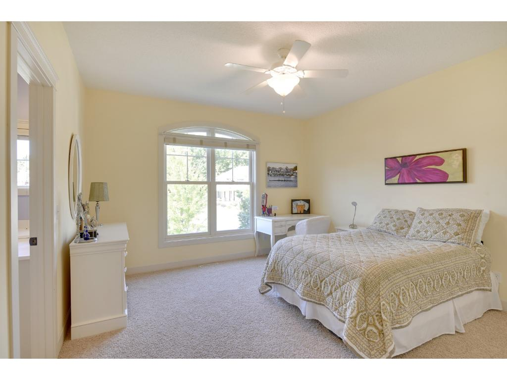 The upper level also hosts two bedrooms with Jack-n-Jill style, 2-room full bath, an additional bedroom en suite with private, laundry room, and bonus room.
