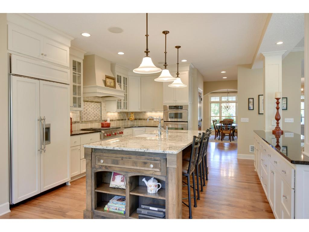 The open floor plan is perfect for entertaining.  The beautifully-appointed kitchen is an entertainers dream. The large center island and outer buffet create division between workspace & guests, as well as ample space to set out your spread.