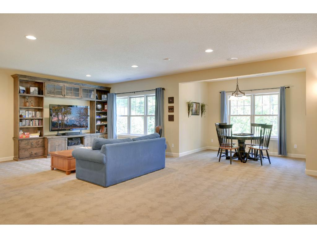 The expansive walkout lower level offers something for everyone including a spacious rec room with plenty of space for media & gaming.
