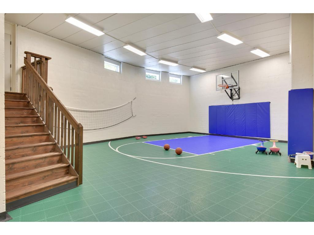 The oversized sport court, along with grassy spaces outdoors and the cul-de-sac location, offer ample space for kids to run, play & practice sports.