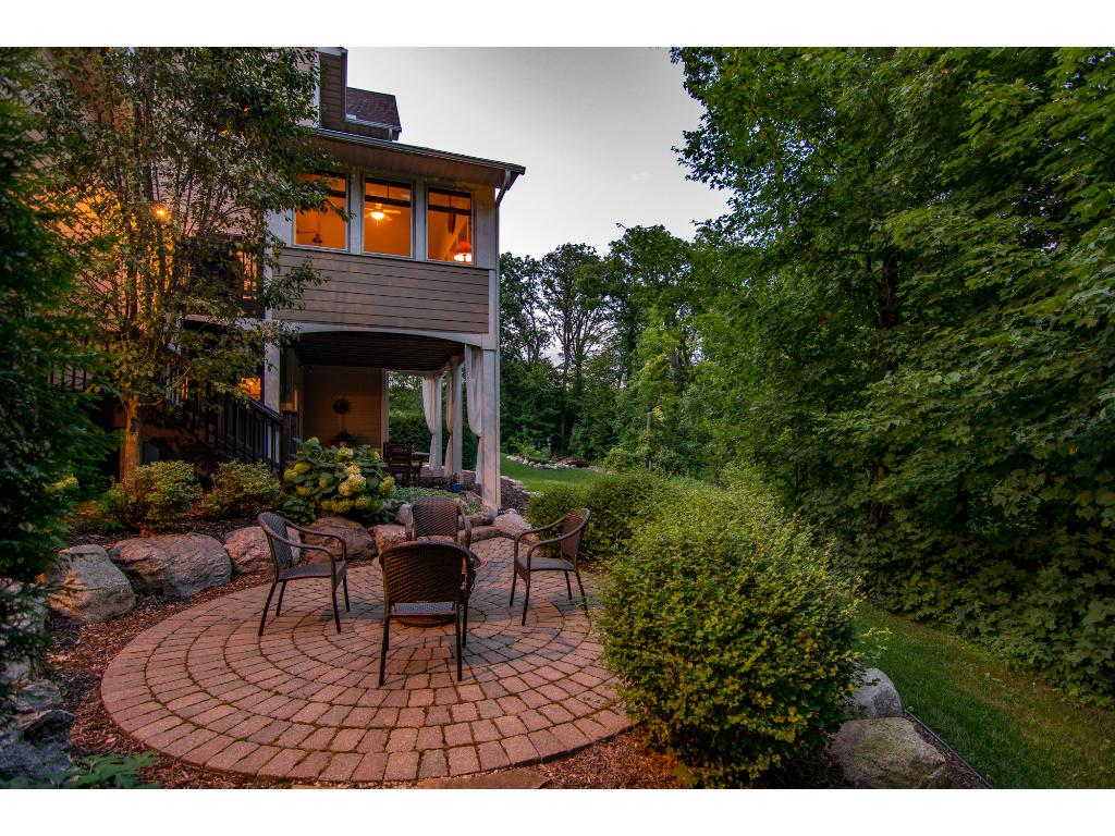 Wrapped in peaceful serenity, the paver patio is private & the perfect place to enjoy a crackling fire.