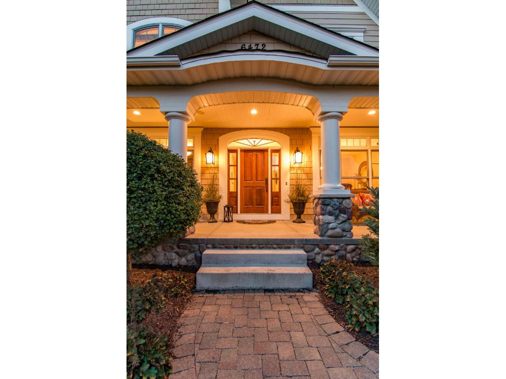 Tremendous curb-appeal with gorgeous architectural detail & extensive landscaping.