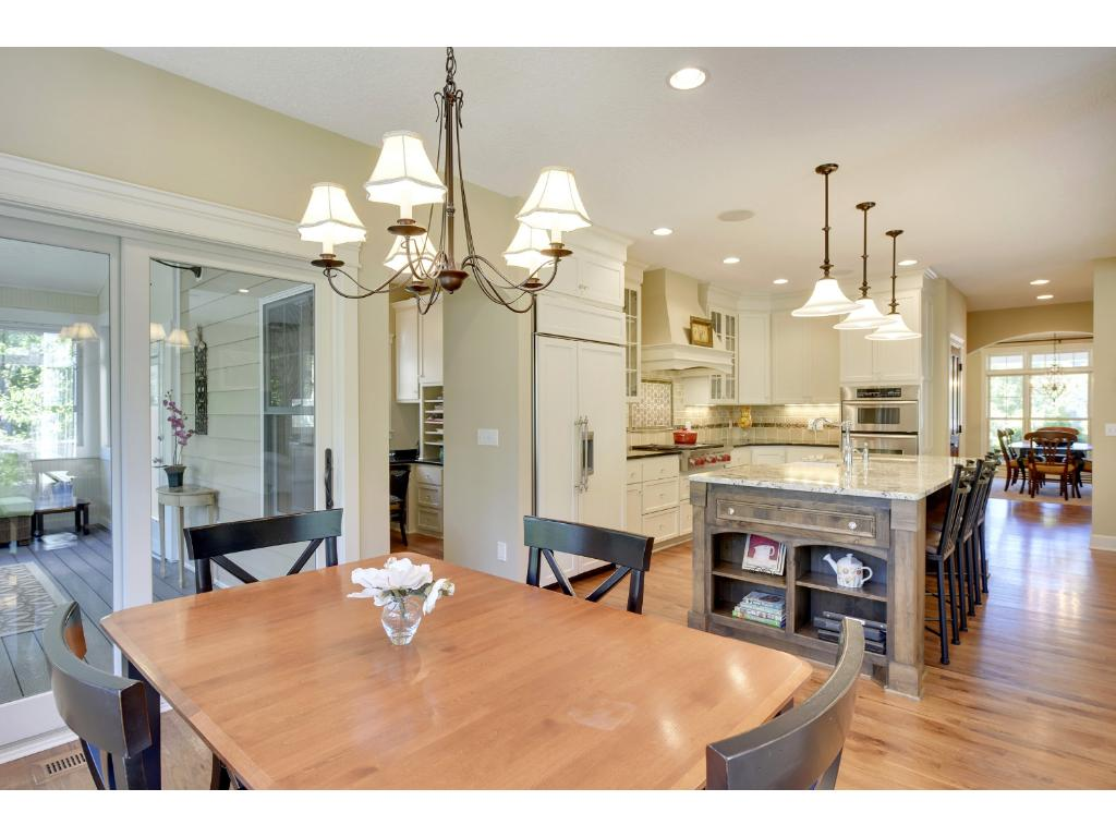 Informal dining off the kitchen with access to the screen porch.
