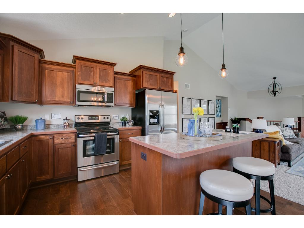 This Open Kitchen With Rich Wood Cabinetry Offers Exceptional Counter Space  And Storage!