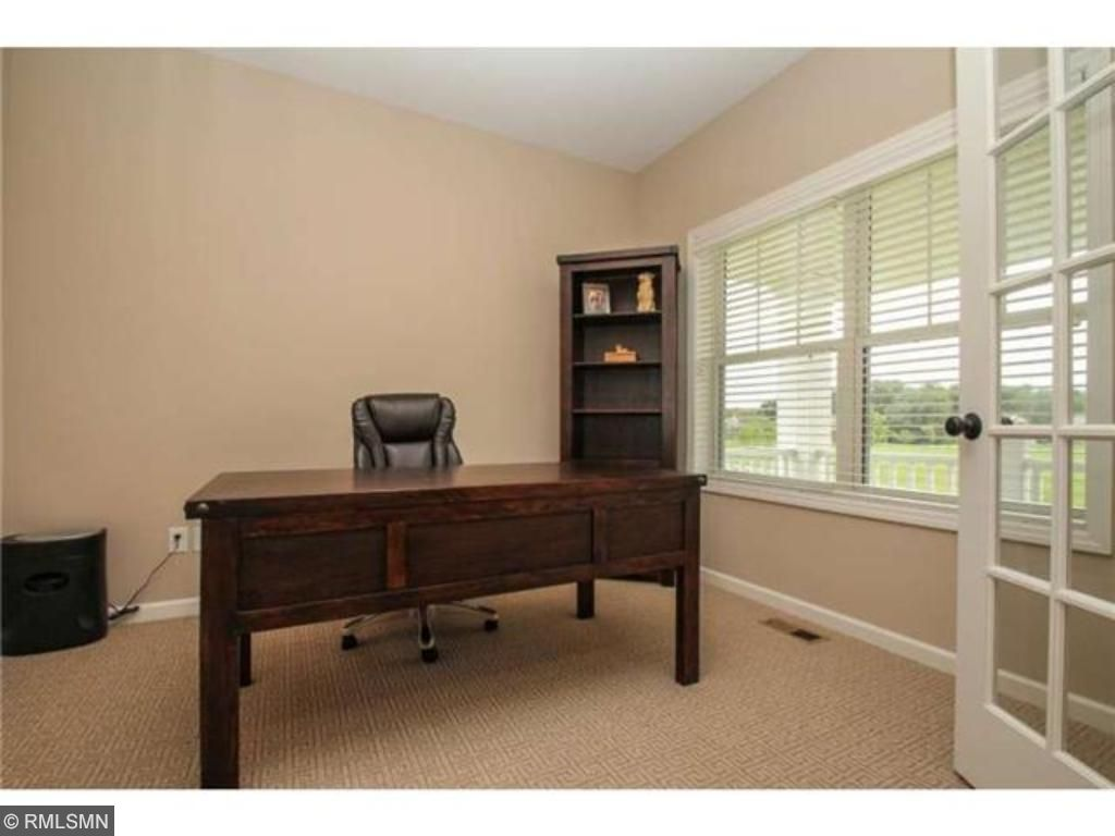 The office has lots of natural light and overlooks the front porch.