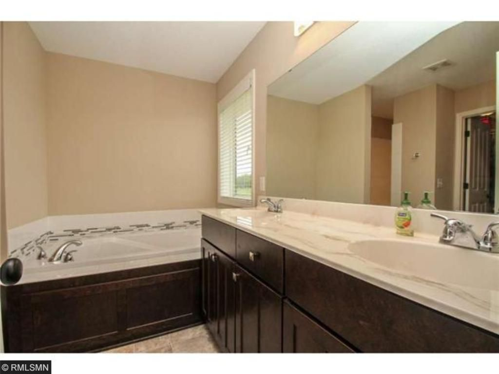 Master bath has a large soaking tub and separate walk in shower.