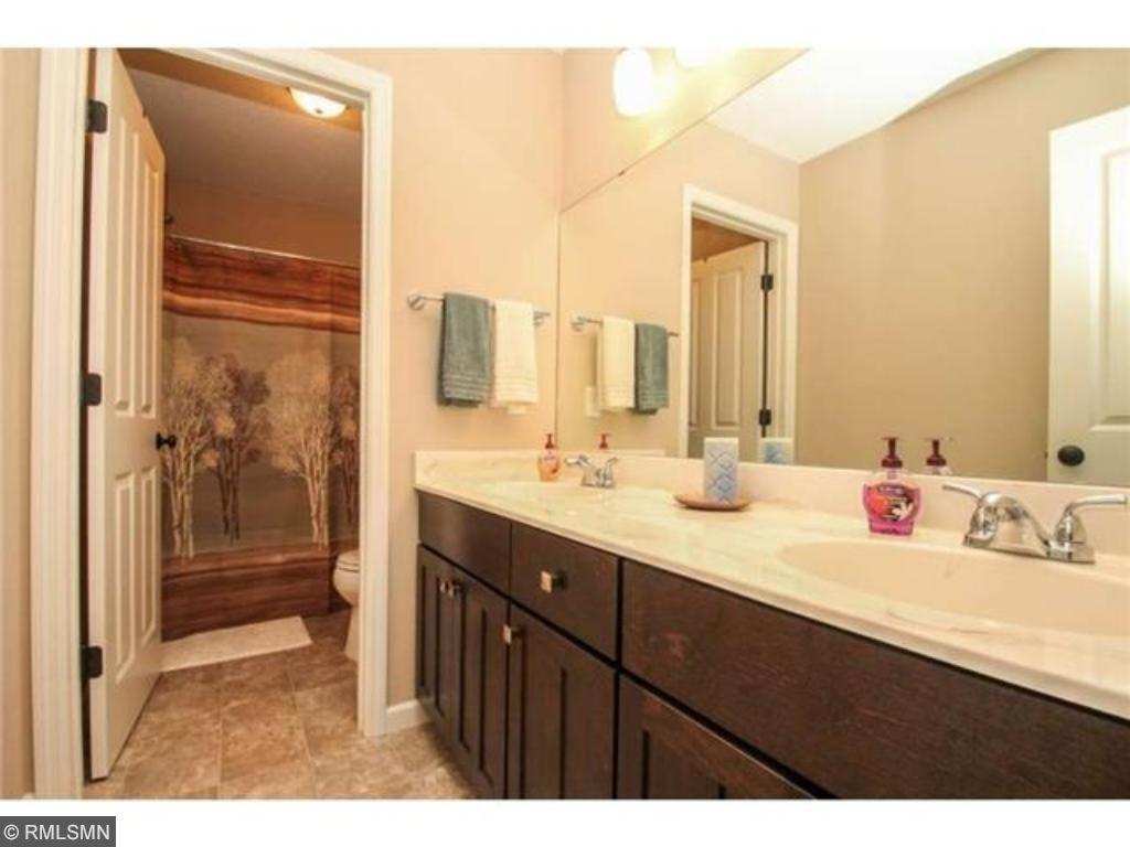 Upper level full bath has double sinks in the vanity.