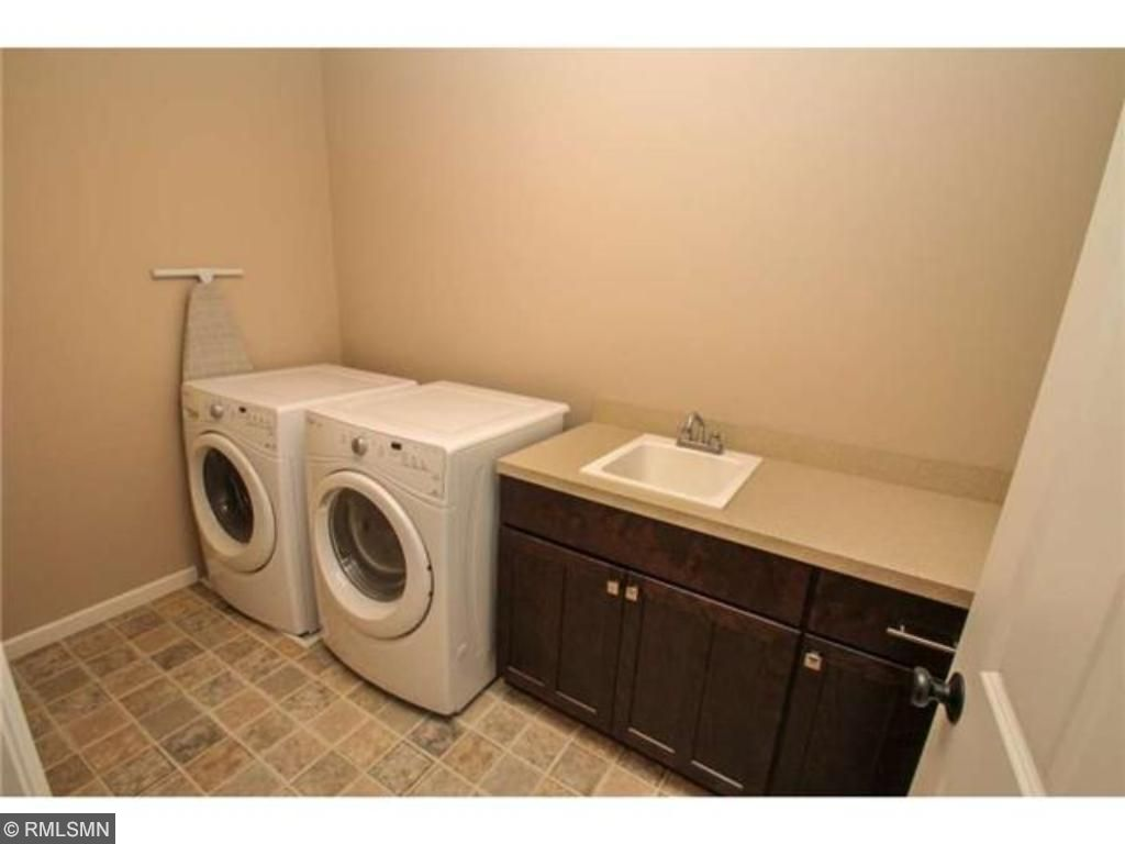 The laundry is conveniently located on the upper level near the bedrooms.