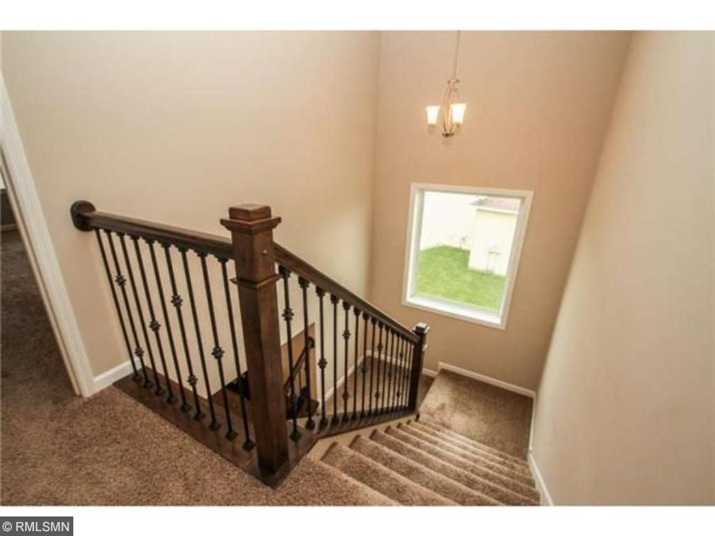 Open stairway and large bright windows.