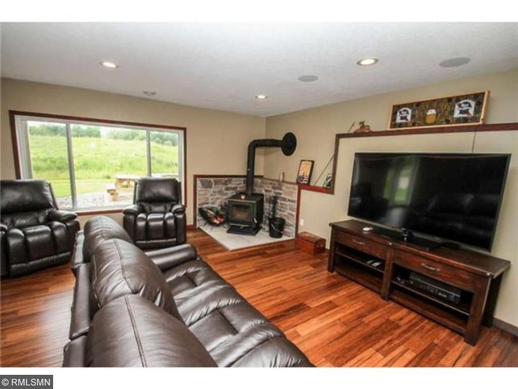 Walkout lower level family room with wood burning stove.