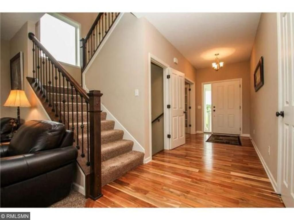 Spacious entry with beautiful hardwood floors