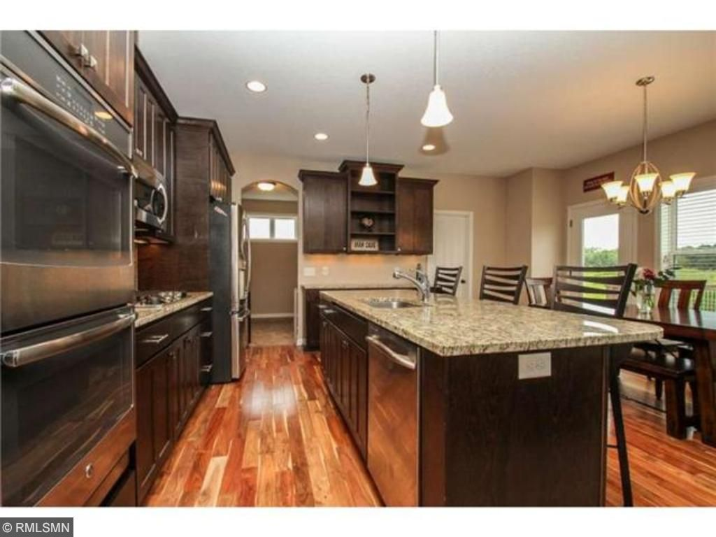 Gourmet kitchen features double ovens, 5 burner cooktop and convention microwave.