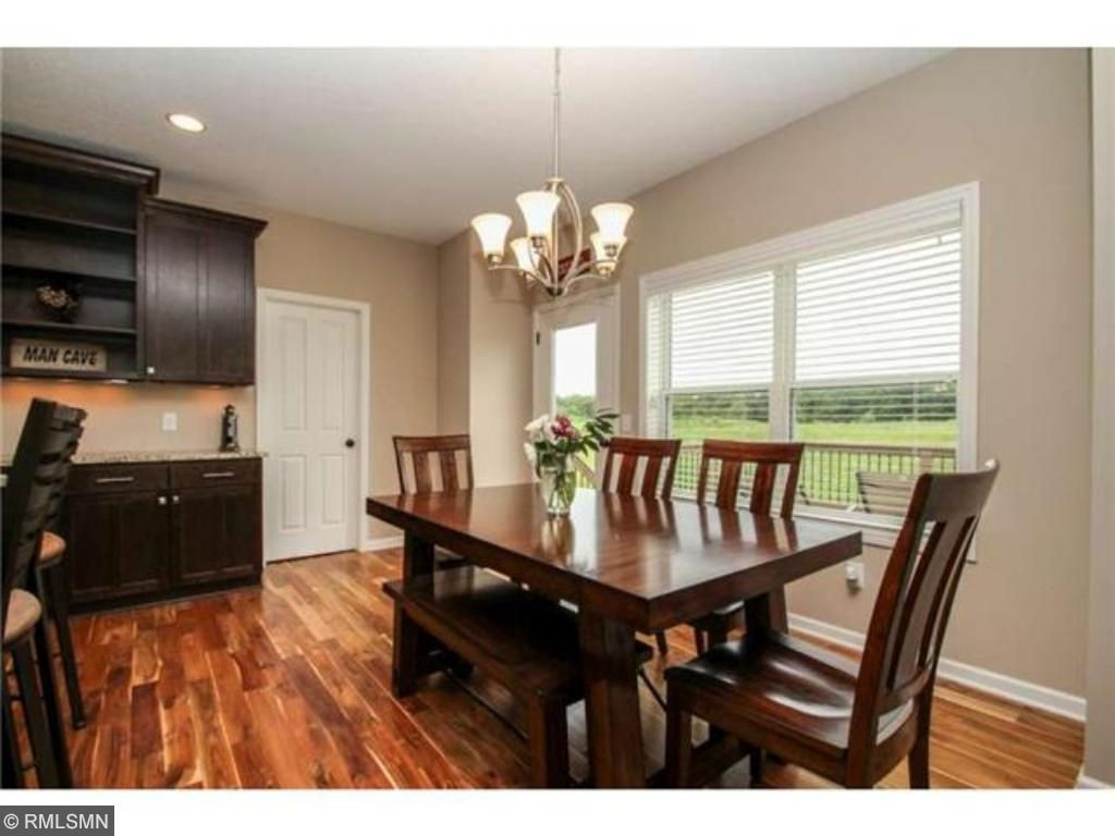 Bright and sunny dining room leads to the Trex deck.