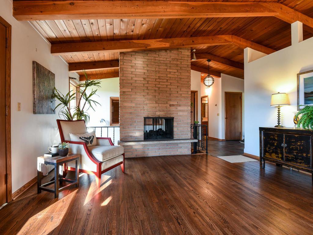 Two sided wood burning fireplace and large foyer
