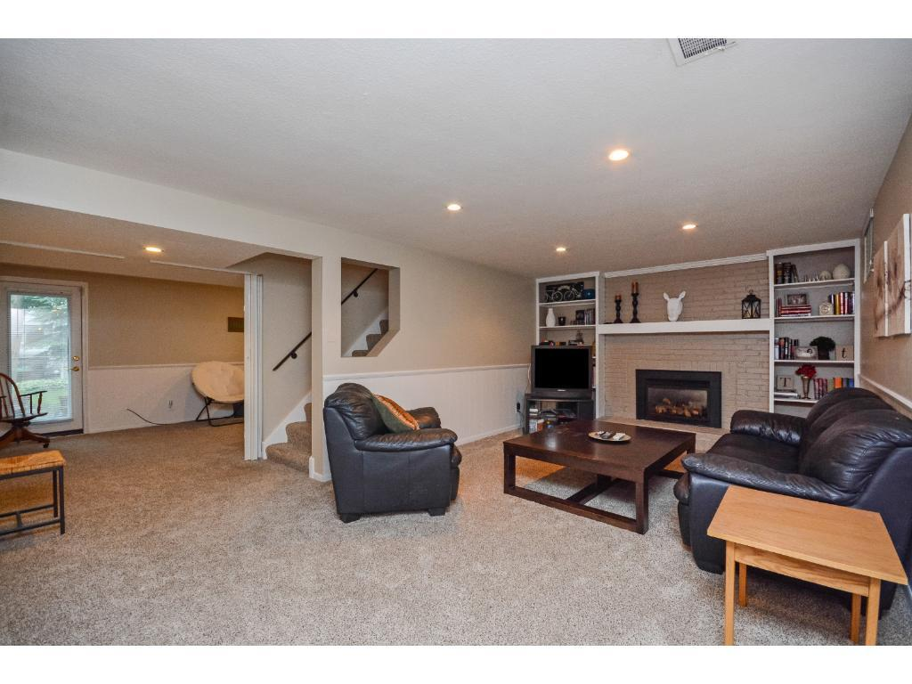Large Walkout Level 2nd Family Room with a Nice Fireplace