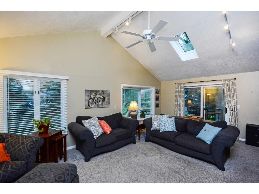 Newer Vaulted Large Main Floor Family Room & Sliding Door to a Wonder 2 Tiered Deck