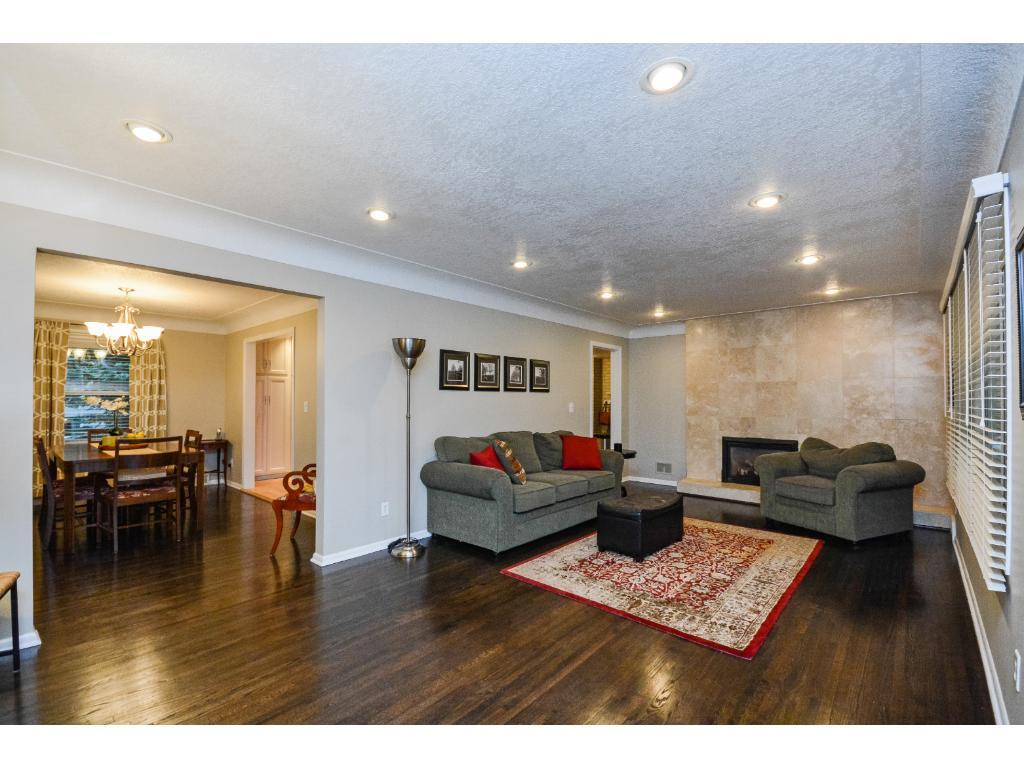 Beautiful Hardwood Floor & a Fireplace in the Nicely Updated Living Room