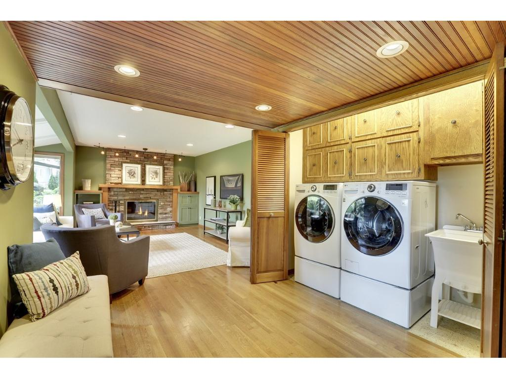Main floor laundry very accessible for a busy household.  Hidden behind folding doors. New front load washer and dryer.