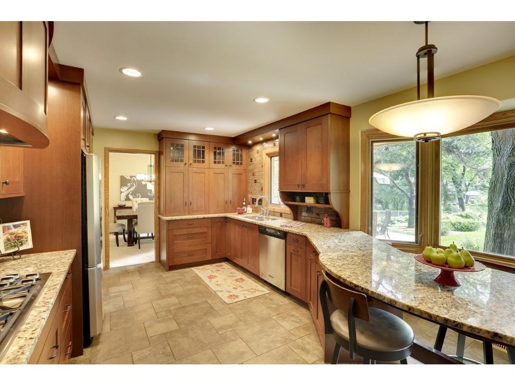 Built in island, gas stove and hood.  Beautiful views from the large windows.