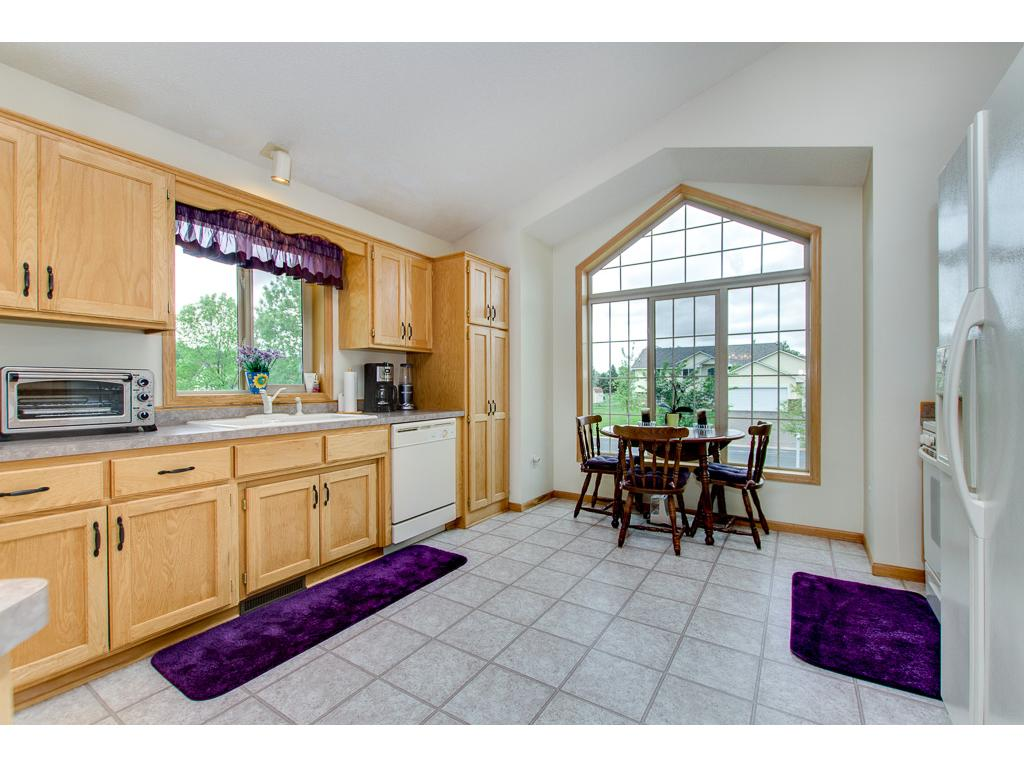 Eat In Kitchen With Beautiful Window And Many Cabinets!