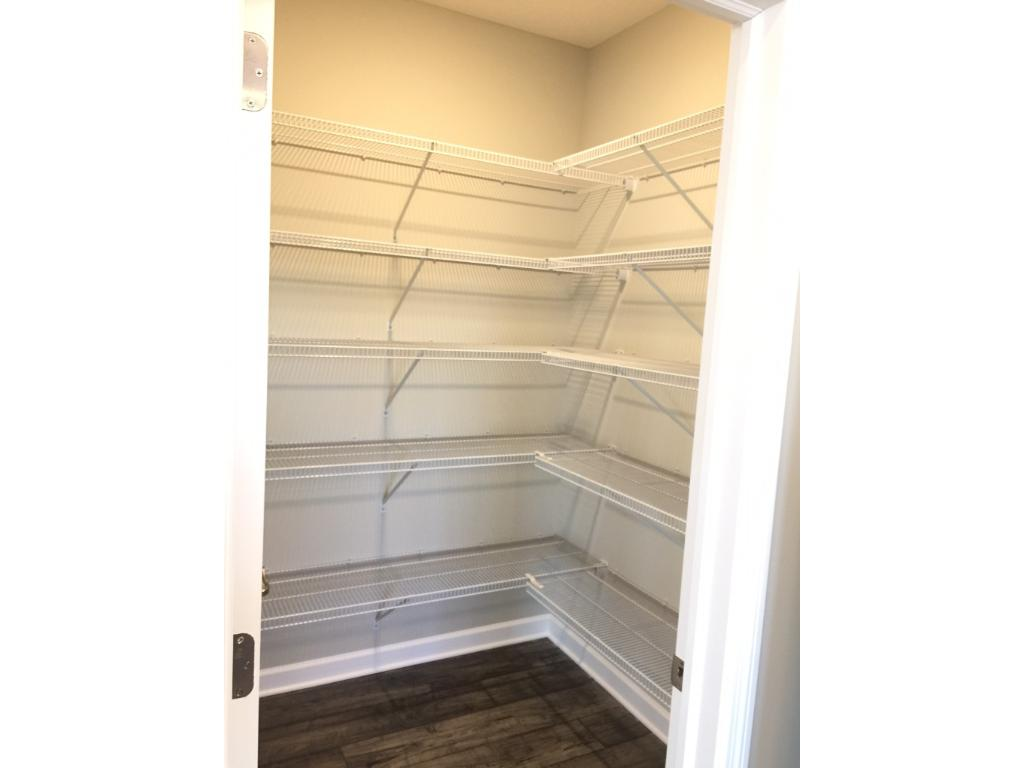 The oversized walk-in pantry offers up tons of storage.