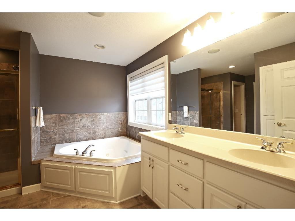 Private Master bath, jetted tub, walk in closet, separate shower.