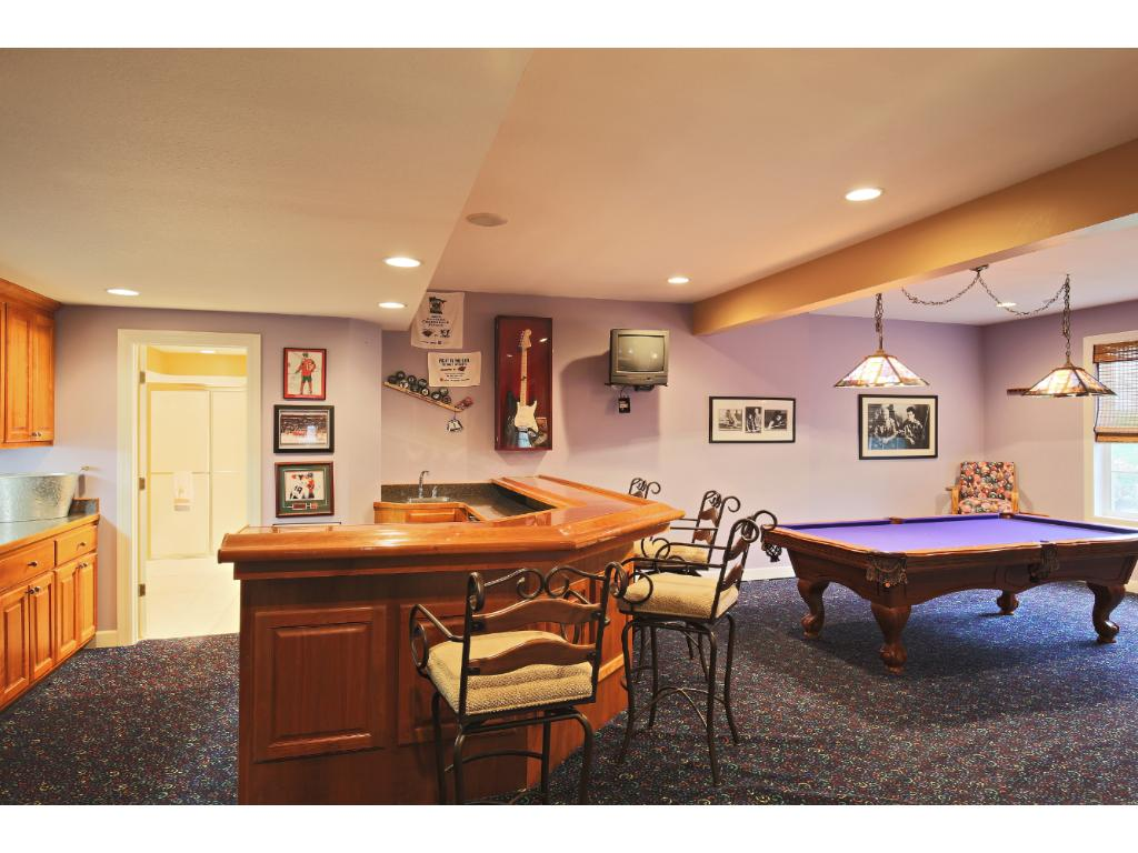 Lower lever family room is open and fun! Generous recreation room & wet bar and the hot tub is nearby too!
