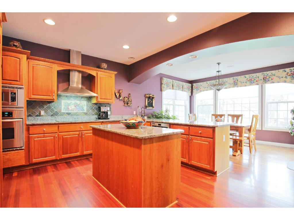 Chef's Kitchen with Cherry hardwood floor and cabinets, granite countertops, stainless appliances, breakfast bar and center island too...great place to gather with friends & family.