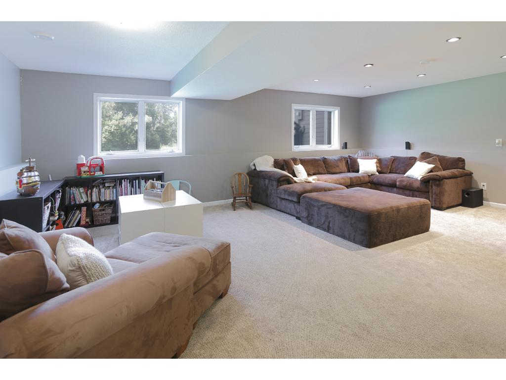 Super spacious lower level is a great hang out space.