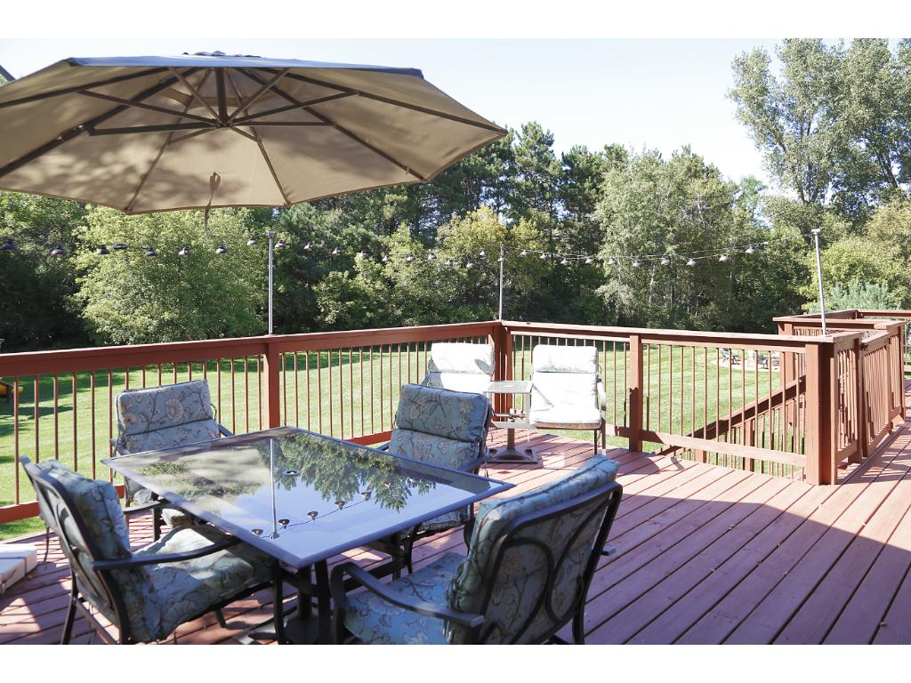 Walk out onto the extra large deck and check out the views! 3.2 acre lot lined with trees, new stamped concrete fire pit, and a park-like lawn.