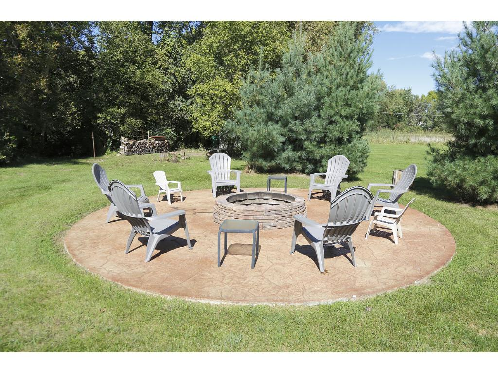 New stamped concrete fireplace is a great spot to relax with friends on an autumn evening.