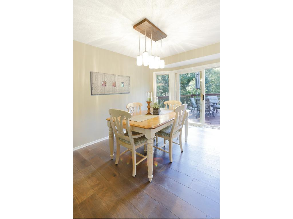 Wide planked hardwood flooring throughout the main level creates a warm and inviting space.