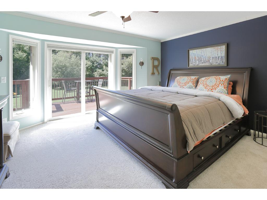 The private master is a true oasis with a patio door that walks out to the deck overlooking the 3+ acre lot.