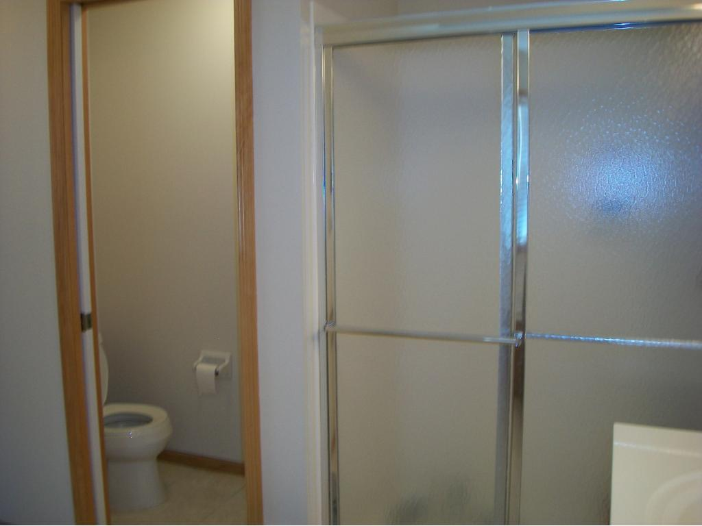 Master Bath w. walk in shower and separate toilet room.