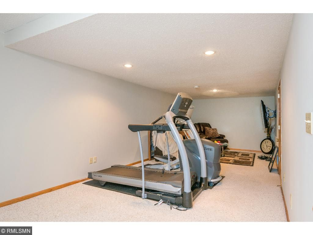 Lower level family room being used as a gym