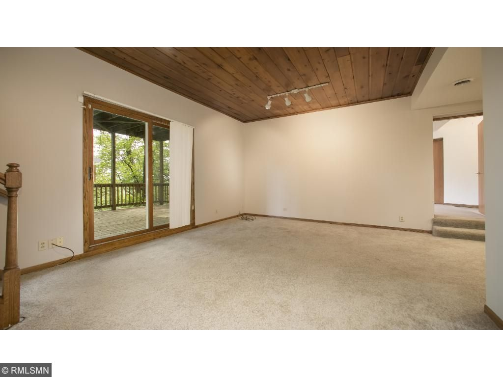Large Lower Level Family Room with Walk-out to Deck (which could be used as a play area or screen in for a porch).